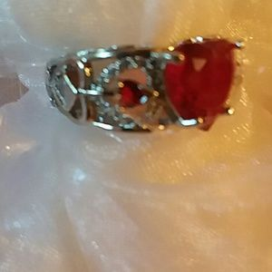 heart shaped red gem in silver and cz on sides